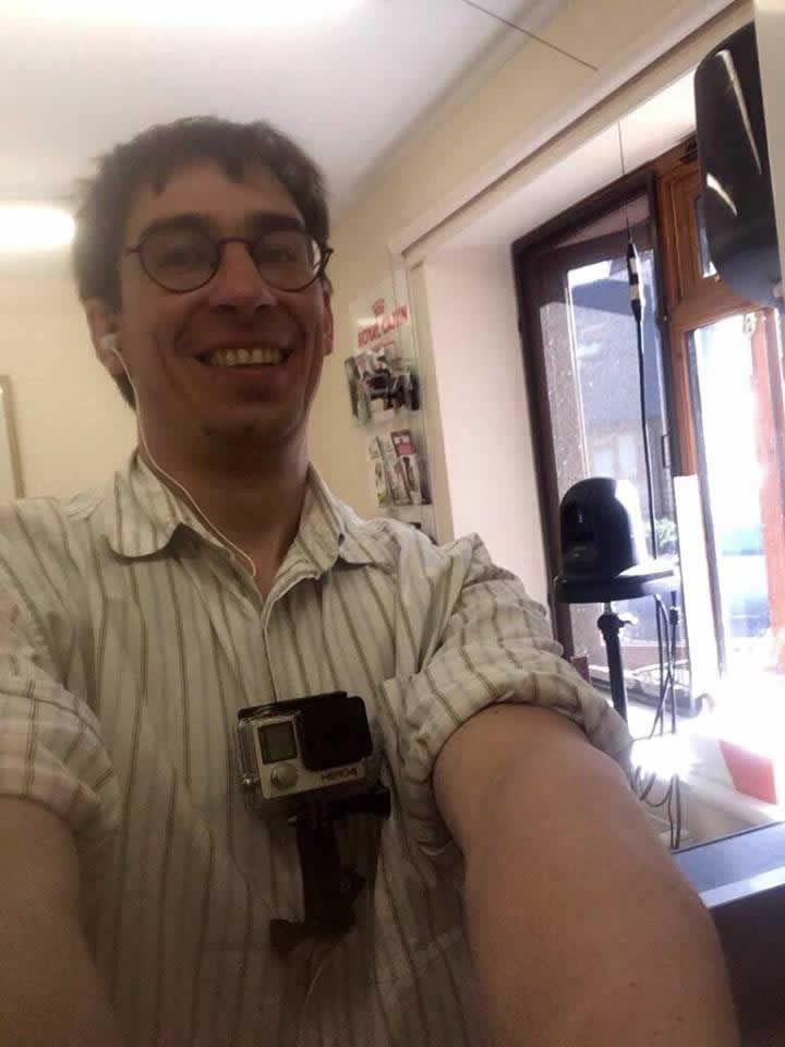 Clive Munns with camera at Montgomery Vets